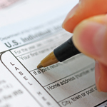 Person filling out tax documents